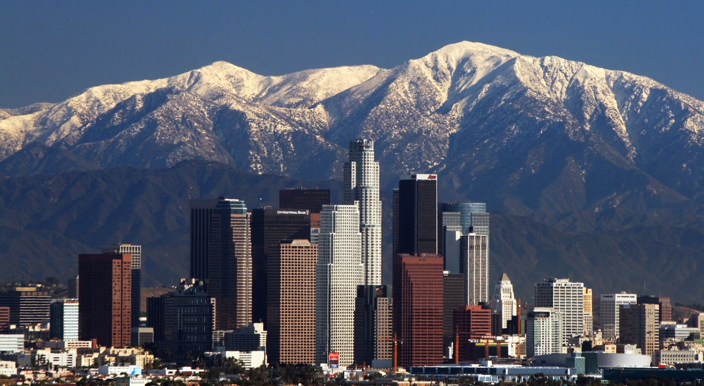 The Los Angeles skyline and San Gabriel mountains. <i>By Nserrano (Own work), via Wikimedia Commons</i>
