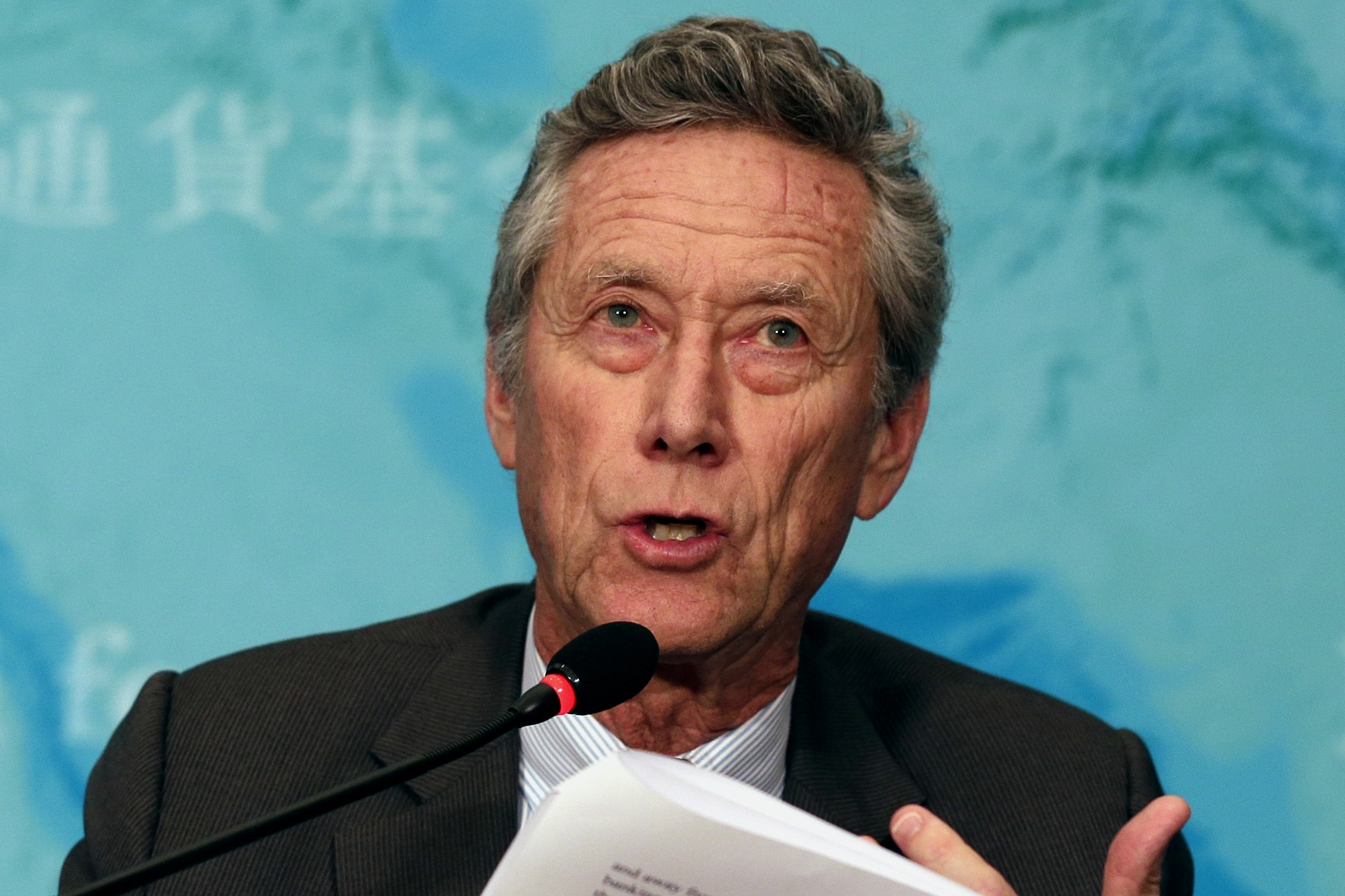 Olivier Blanchard speaks during a press briefing at a hotel in Beijing, China, Tuesday, January 20, 2015. (AP Photo/Andy Wong)