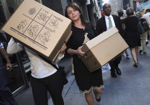 Women carrying boxes leave the Lehman Brothers headquarters, Sept. 15, 2008, in New York.  (AP Photo/ Louis Lanzano)