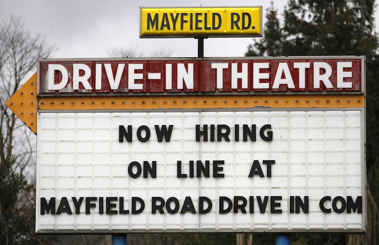 A help-wanted sign displays outside the Mayfield Drive-In movie theater in Chardon, Ohio. U.S. job growth slowed in January, with employers adding 151,000 jobs last month, compared to the 262,000 jobs added in December.