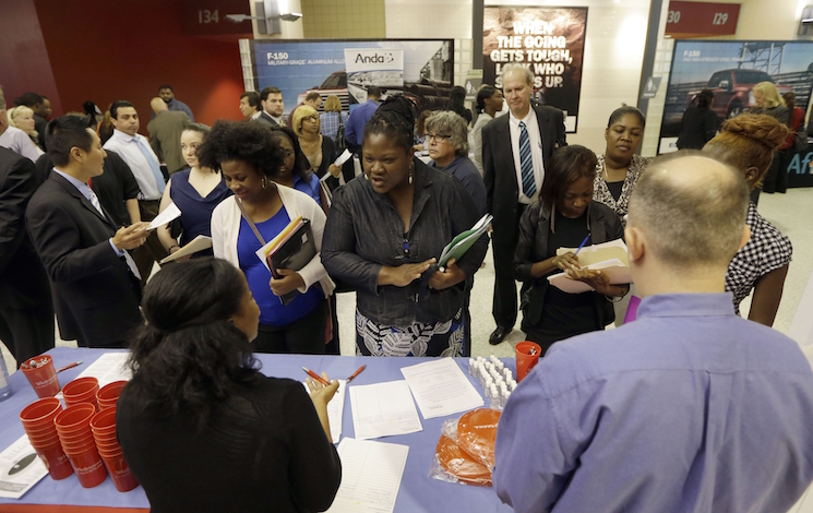 In this photo taken Wednesday, June 10, 2015, Job seekers attend a job fair in Sunrise, Florida, June 10, 2015. (AP Photo/Alan Diaz)