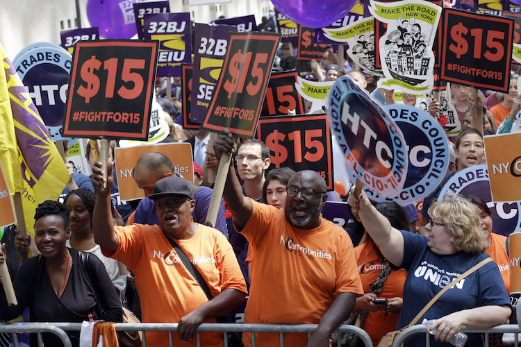 Activists cheer during a minimum wage rally in New York.