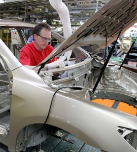 The March 2011 earthquake knocked out many Japanese parts makers, resulting in factory shutdowns, including this one for a few days, and model shortages around the world. (AP Photo/James Crisp)