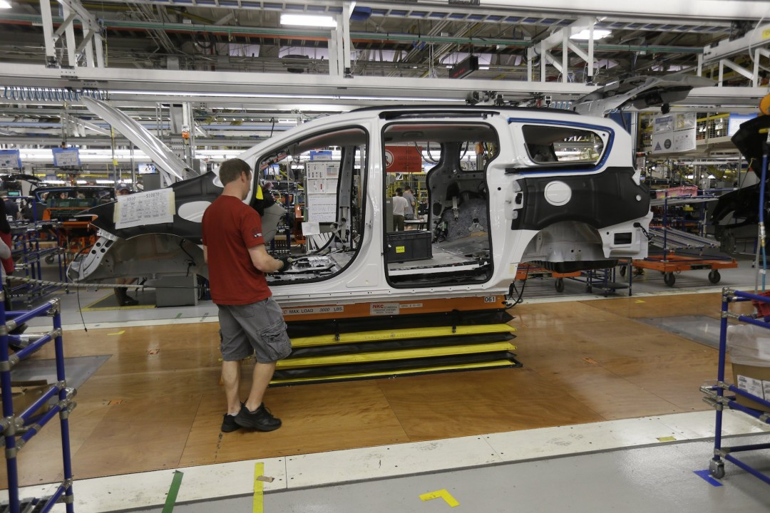 Steve Vince works on a 2017 Chrysler Pacifica on the assembly line at the Windsor Assembly Plant, Friday, May 6, 2016 in Windsor. (AP Photo/Carlos Osorio)