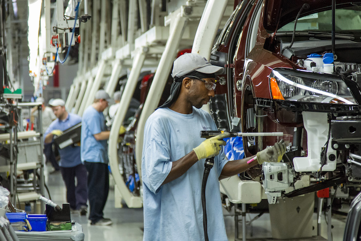 Workers assemble Volkswagen Passat sedans at the automaker's plant in Chattanooga, Tenn.