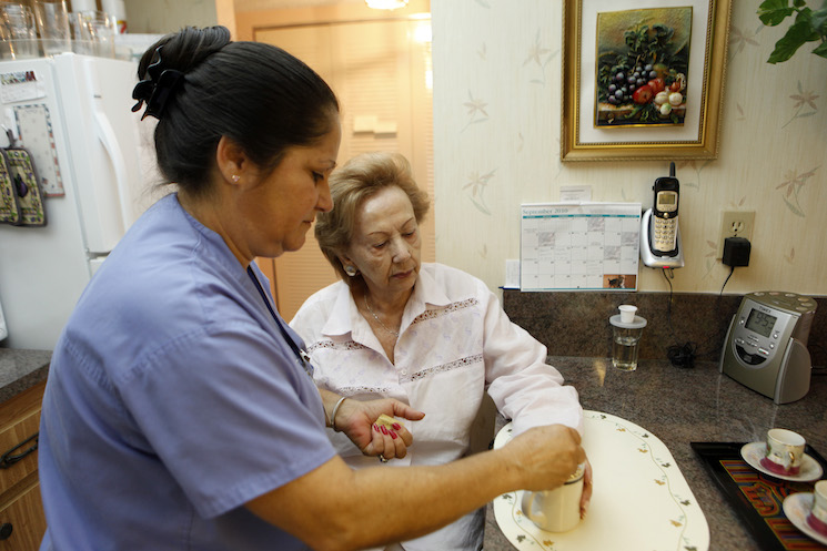 Home health aide Maria Fernandez, left, makes coffee for Herminia Vega, 83, right. Employment for home health aides is expected to grow 38 percent, much faster than average for all occupations.