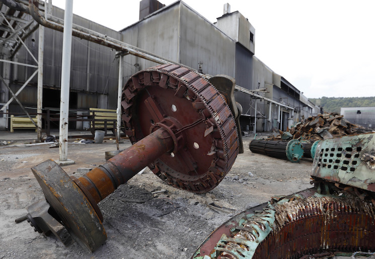 Photo of a gear from an air compressor that provided plant air for the former Ormet plant lies on the ground at the site in Hannibal, Ohio. Manufacturing's decline has impacted local marriage and fertility rates, but in different ways depending on whether the affected industry is male- or female-intensive.
