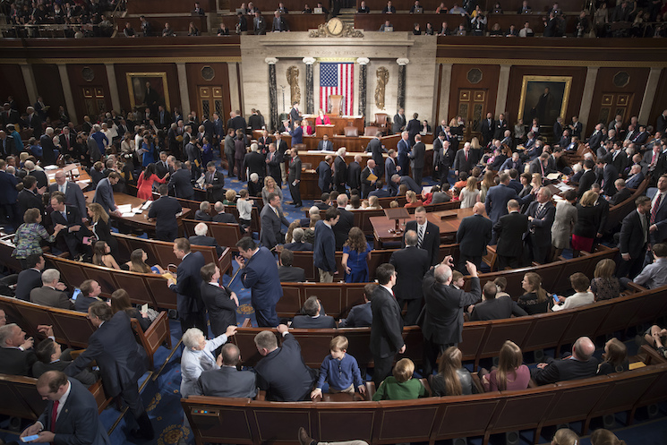 Members of the House of Representatives gather in the chamber last month (AP Photo/J. Scott Applewhite).
