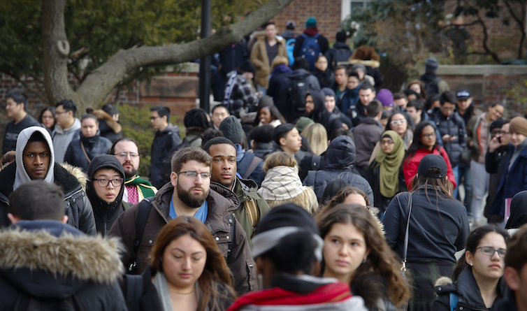Brooklyn College students walk between classes on campus in New York.