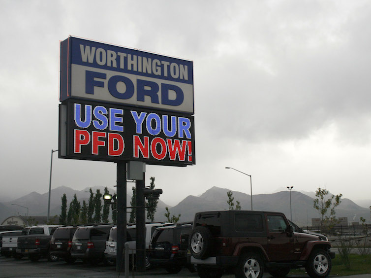 An auto dealership in Anchorage, Alaska, advertises PFD, or Permanent Fund Dividend, sales.