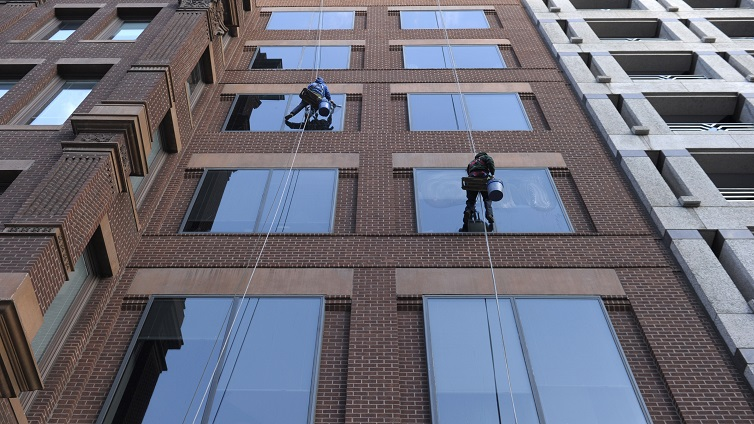 Window washers clean windows on a building in Washington.