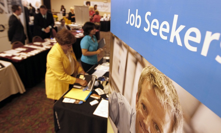 People walk by the recruiters at a jobs fair in the Pittsburgh suburb of Green Tree, Pennsylvania.
