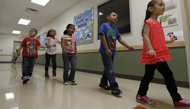 Pre-K students walk in a line at the South Education Center in San Antonio, Texas.