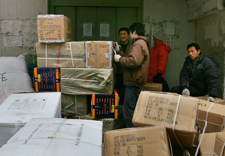 Chinese workers prepare to send off goods meant for export in Beijing.