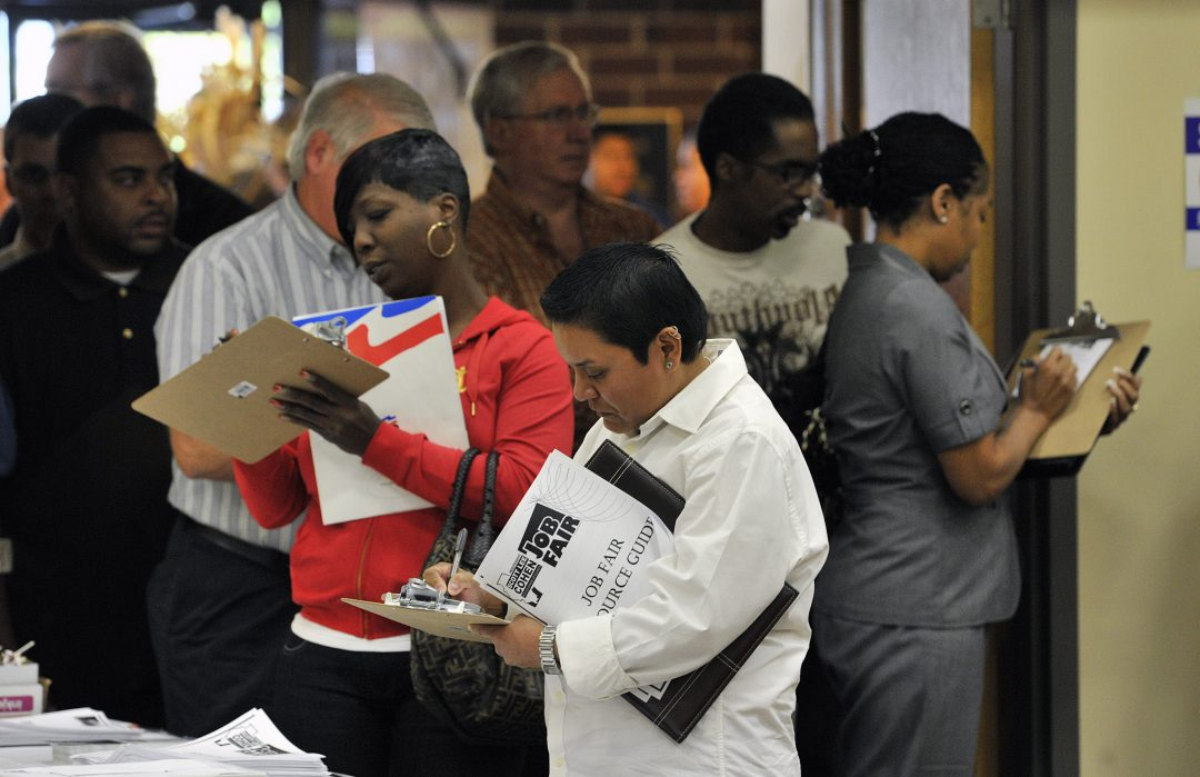 Unemployed workers fill out applications during a jobs fair sponsored by Scott Lee Cohen, independent candidate for governor of Illinois, October 2010, in Rockford, Illinois.