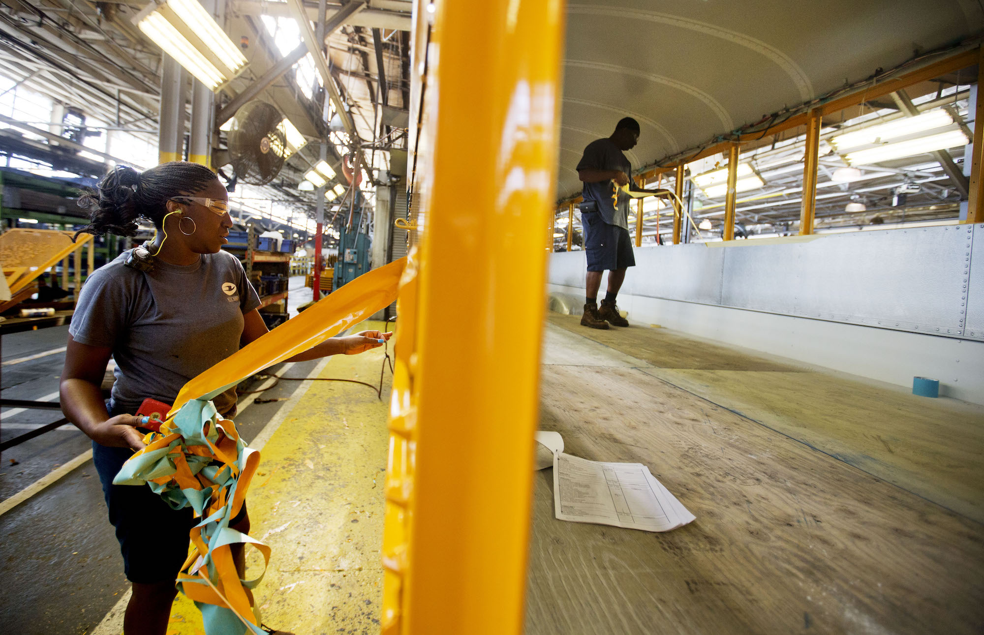 Employees work on a school bus on the assembly line at Blue Bird Corporation's manufacturing facility in Fort Valley, Ga. (AP Photo/David Goldman)