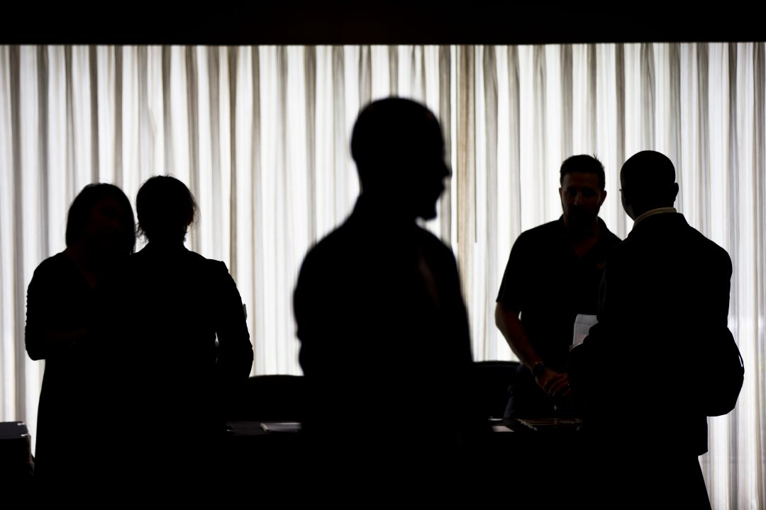 Job seekers and recruiters meet during a job fair in Philadelphia, June 2014.