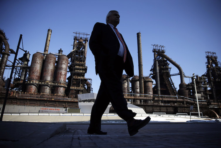 A man walks past the former Bethlehem Steel in Bethlehem, Pa.