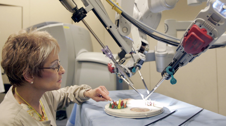 Nurse Charlene Amato-Geib looks at the da Vinci Surgical Robot being demonstrated at Allegheny General Hospital, in Pittsburgh.