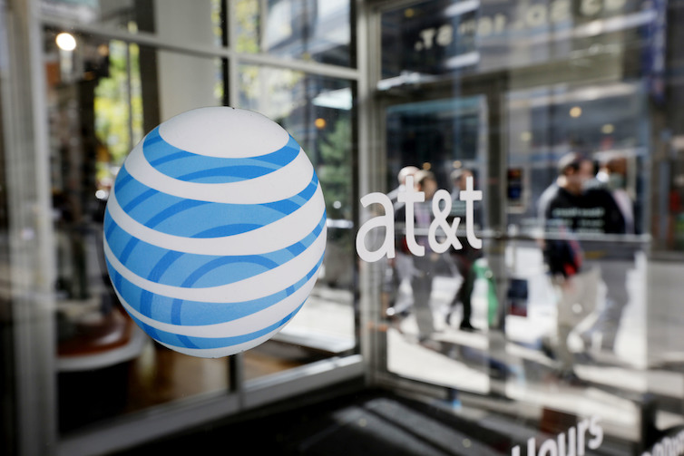 An AT&#038;T Inc. logo on a retail store front in Philadelphia. The Department of Justice recently announced it was suing to block AT&#038;T&#8217;s acquisition of Time Warner Inc.<br />