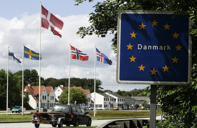 A car crosses the border into Denmark. A new working paper looks at the effect of a Danish wealth tax on wealth accumulation and inequality.
